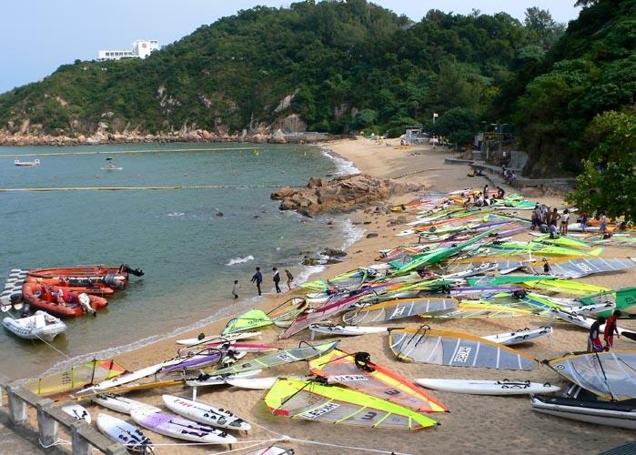 Taking a break - windsurfers on the beach, Cheung Chau island, Hong Kong.