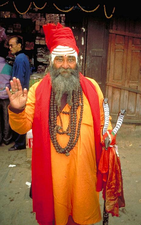 "Freelance holy man, Patan. ""Suddenly a wild man with long unkempt hair and bedraggled beard confronted us."""