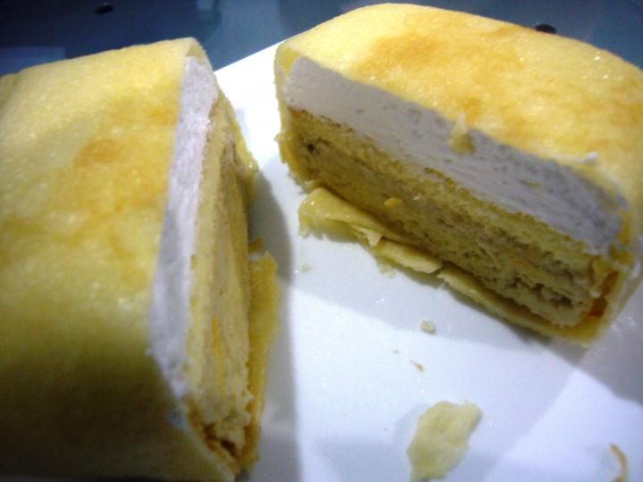 Durian pancake with the layers of durian flesh, cake, and cream.