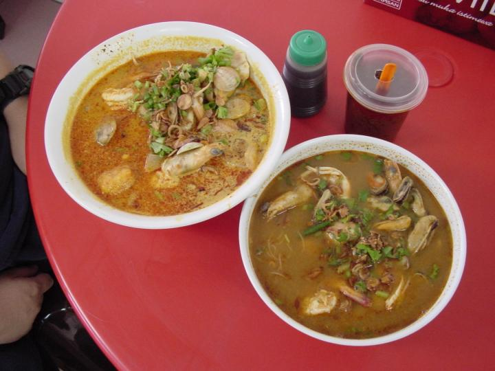 Curry seafood noodles (left) and tom yam seafood noodles (right)