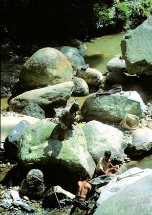 Rumtek, Sikkim, India: Workmen break rocks in the Rehpola River, near the village of Adampol.