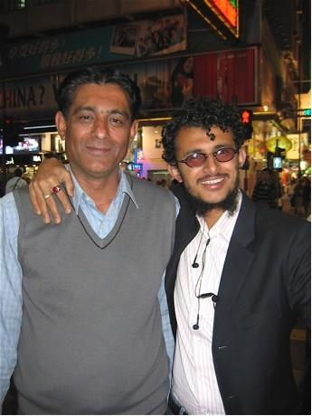 Two salesmen from Pakistan outside Chung King Mansion in Hong Kong