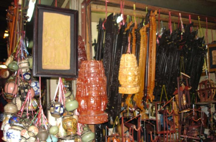Opium pipes, picture frames, and carvings. Phnom Penh, Cambodia.