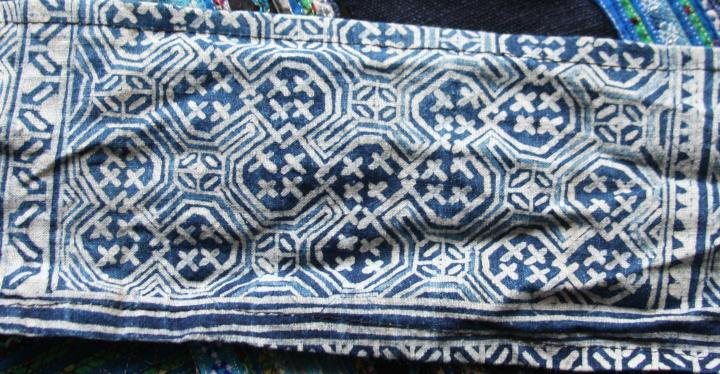 Indigo batik on cotton. This intricate design has been recycled - once used in a skirt, it's now used as straps on a baby-carrier that has been used for a half-dozen children.