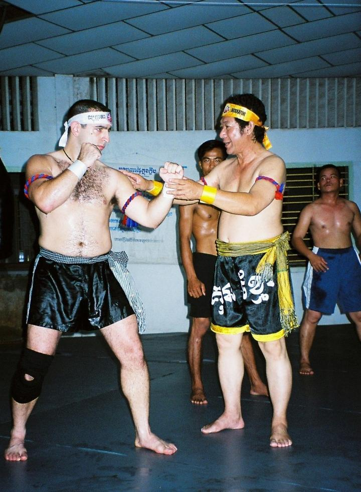 Antonio Graceffo (left) learns the Khmer martial art of Bokator under the watchful eyes of Master San Kim Saen in Phnom Penh.