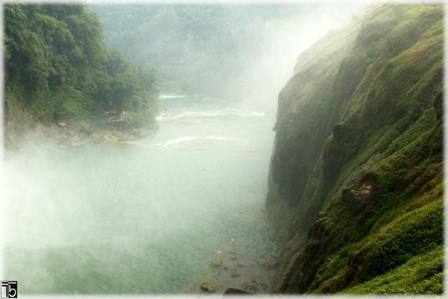Spindrift of the Huangguoshu waterfall spraying through the valley (Guizhou province)