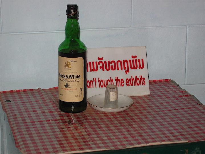 Communist leader Kaysone's whiskey bottle and glass