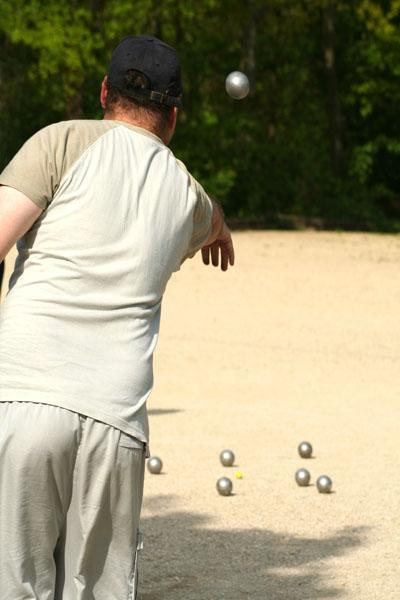 A casual game of pétanque. This sport is part of the 25th SEA Games in Laos.