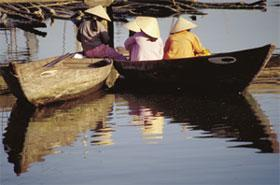 Small boats on the bank of the Thu Bon River. From the 17th to the 19th centuries Hoi An was among the most active ports in Southeast Asia. Today, fishing boats still go down the Thu Bon River to the South China Sea for their catch.