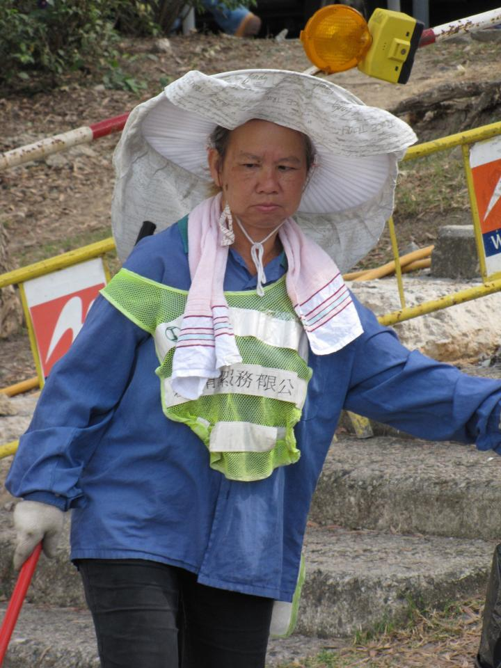 Street cleaners in Hong Kong have unique headgear.