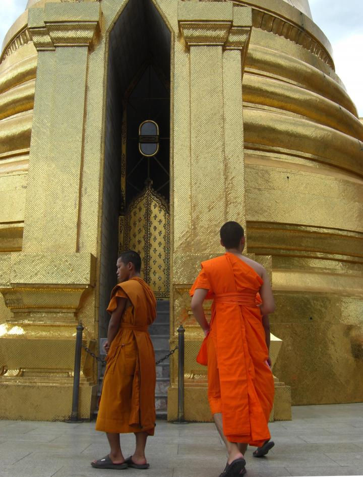 Saffron-robed monks of the Grand Palace, Bangkok