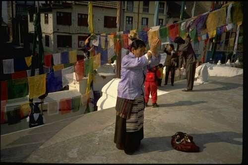 Tibetan pilgrim at the Great Stupa at Boudhnath, the spiritual and commercial center of the Tibetan community in the Kathmandu Valley