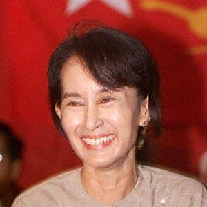 Burmese democracy leader Aung San Suu Kyi smiles at a question during a press conference in Yangon in 2002.