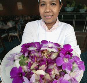 A Thai chef shows an orchid salad made with flowers at a restaurant at the Rose Garden resort in Nakhon Pathom province.