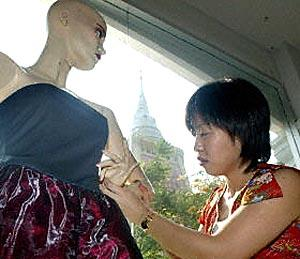 A Thai design student works on a creation during her fashion course at the Wat Dammamongkol temple in Bangkok.