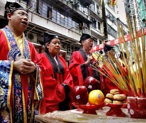 People chant during a ceremony of the Hungry Ghost festival in Hong Kong.
