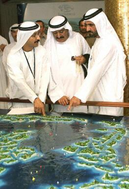 Crown Prince Sheikh Mohammed bin Rashed al-Maktum (R) looks at a display showing the Atlantis man-made island project during a launching ceremony of the luxurious 2,000-room resort and water theme park off the coast of Dubai, 21 September 2003 at a hotel in the Gulf emirate. The 650-million dollar first phase of the Atlantis' project, which is inspired by Kerzner International's Paradise Island in the Bahamas, adds to a boom in tourist infrastructure investment in Dubai, including the construction of dozens more five-star hotels. The project is a joint venture between Kerzner and Dubai's property developer Nakheel LLC.