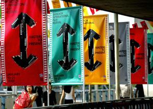 Thais walk past rows of banners and signs advertising the Bangkok International Film Festival.