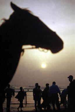 A view of a beach in Cox's Bazar resort during sunset, 06 December 2002. Bangladesh's fledgling but troubled tourism industry is slowly luring foreign and domestic travellers with one of the most popular destinations this winter being this beach resort town of Cox's Bazar on the Bay of Bengal, which drew sun-worshippers from as far away as Europe and Southeast Asia.