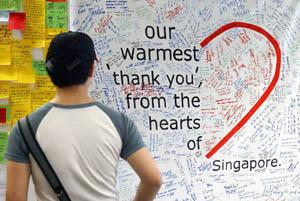 A man reads messages by Singaporeans' thanking health-care workers caring for SARS patients. Over 1,200 handwritten messages of gratitute and encouragement were displayed in this subway station.