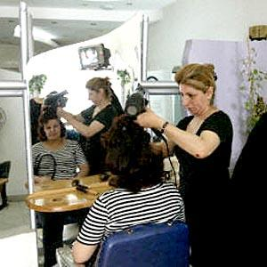 An Iraqi woman has her hair styled at the most chic women's hairdresser in Baghdad.