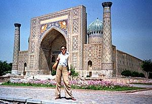 A tourist poses in front of Ragestan palace, in the ancient Uzbek city of Samarkand. This large city of Islamic art was founded in V century B.C.