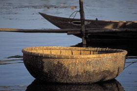 A small basket boat on the river at Hoi An.