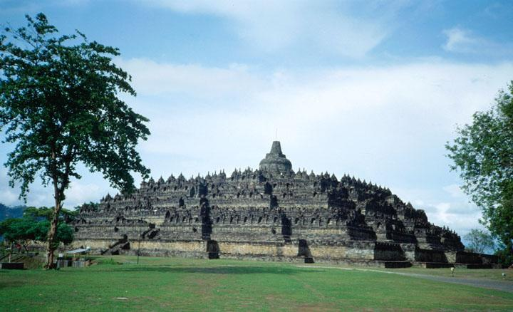 Located on Indonesia's island of Java, twenty-six miles northwest of Yogyakarta, the ancient sanctuary Borobudur is the world's largest Buddhist monument. Dating from the mid eighth century AD, and constructed over a period of over a hundred years, Borobudur was mysteriously abandoned early in the tenth century.