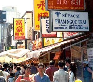 Shop signs reveal the growing Vietnamese presence in Toronto's Chinatown.