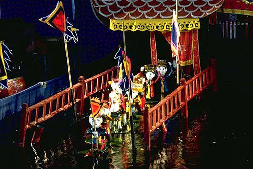 Flags are hoisted to signal the start of the show - springing up from beneath the water's surface; they somehow emerge completely dry.