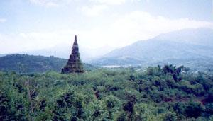 Landscape, Xieng Khuang, Lao. This was once a provincial capital. During the Secret war it was devastated by carpet bombing. Now this lone chedi stands as a memorial to the lost city.