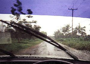 A rainstorm in southern Thailand seen from behind the wheel.
