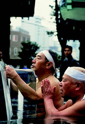 The water is coldGive me strength to endure itAs I purge myselfOn the second Sunday of the New Year, wearing nothing more than loincloths called shitaobi and headbands called hachimaki, many Japanese men brave the icy waters of Teppozu Inari Jinja, a Shinto shrine in central Tokyo, to practice a yearly purification ritual.