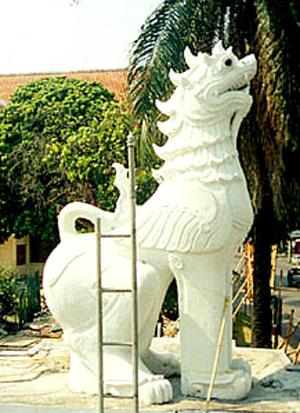 The singh, or lion-dragon, typically appears sitting at entrances to a wat, including Bangkok's Wat Phra Keo. Harmless to humans, the singh inhabits the mythical forest Himaphan, a place of never-ending rice.