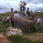 Visitors from nearby Vietnam explore the Plain of Jars