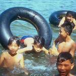 Boys swimming in the Perfume River