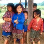 Hmong children at Thong Hai Hin on the Plain of Jars. This hilltribe community has been resettled just outside the provincial capital.