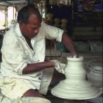 As the wheel turns, the clay seems to become liquid, flowing gracefully between Krishnan's fingers.