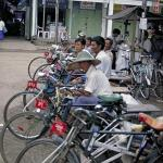 Rickshaw drivers lay in wait for customers.