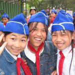 excited school girls greet us at Ho Chi Minh's tomb