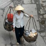 Basket lady carrying her mobile tea stand