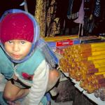 Very young incense vendor along the streets of Thamel.
