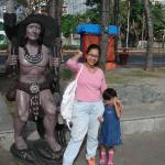My girl and I with a statue at Baywalk