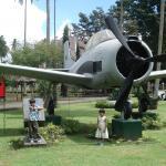 Posing with the WWII memorabilia