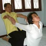 Thai massage at Wat Po, Bangkok, Thailand.