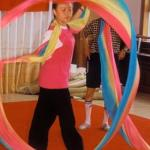 A student gracefully practices banner swirling, at the Children's Palace. Shanghai, China.