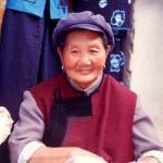 A Bai nationality lady, in Lijiang Old Town. Lijiang, Yunnan, China.
