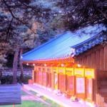 Sunrise gilds a pavilion at Naksansa Temple.