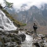 A waterfall across the path through Tiger Leaping Gorge