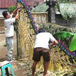 The front gate of a family compound in Bali is decorated for a wedding.